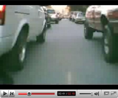 Long line of cars bike commute video