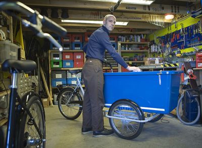 Henry in WorkCycles workshop with bakfiets