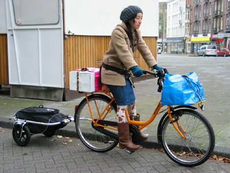 kyoko inatome on her custom workcycles transport bike with carry freedom trailer