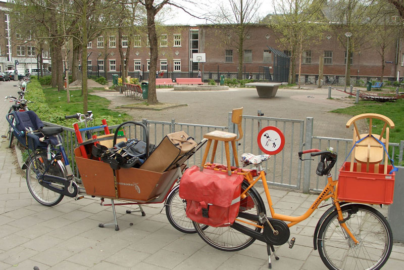 carrying stuff on queen\'s day with a bakfiets and transportfiets